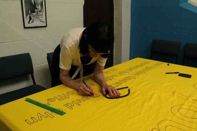 Queer Banner ~ Lulu doing outlines ~ 8 April 2014 (1) (640x427).jpg