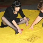 Queer Banner ~ Sarah and Lulu doing layout ~ 8 April 2014 (6) (640x427).jpg